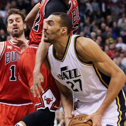 Utah Jazz center Rudy Gobert (27) moves to the basket with Chicago Bulls forward Taj Gibson (22) above him and Chicago Bulls center Pau Gasol (16) at left during NBA basketball in Salt Lake City, Monday, Feb. 1, 2016.