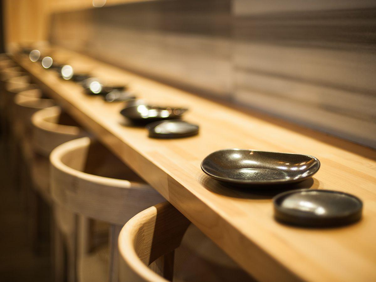 Hamasaku's wood bar setup with plateware.