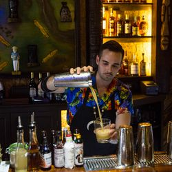 Aaron Doherty pouring a drink