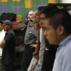 Dozens of immigrants, many of them Mexican citizens, gather in sleeping quarters at a well known immigrant shelter, as many are making tough decisions on whether to try their luck at trying to make it to the United States, by illegally crossing the border, Thursday, Aug. 9, 2012, in Nogales, Mexico.  The U.S. government has halted flights home for Mexicans caught entering the country illegally in the deadly summer heat of Arizona's deserts, a money-saving move that ends a seven-year experiment that cost taxpayers nearly $100 million.