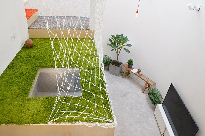 Grass carpeted play area