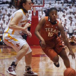 Texas guard Yvonne Anderson drives past Iowa State forward Chelsea Poppens during the first half on Monday, Feb. 21, 2011, in Ames, Iowa.