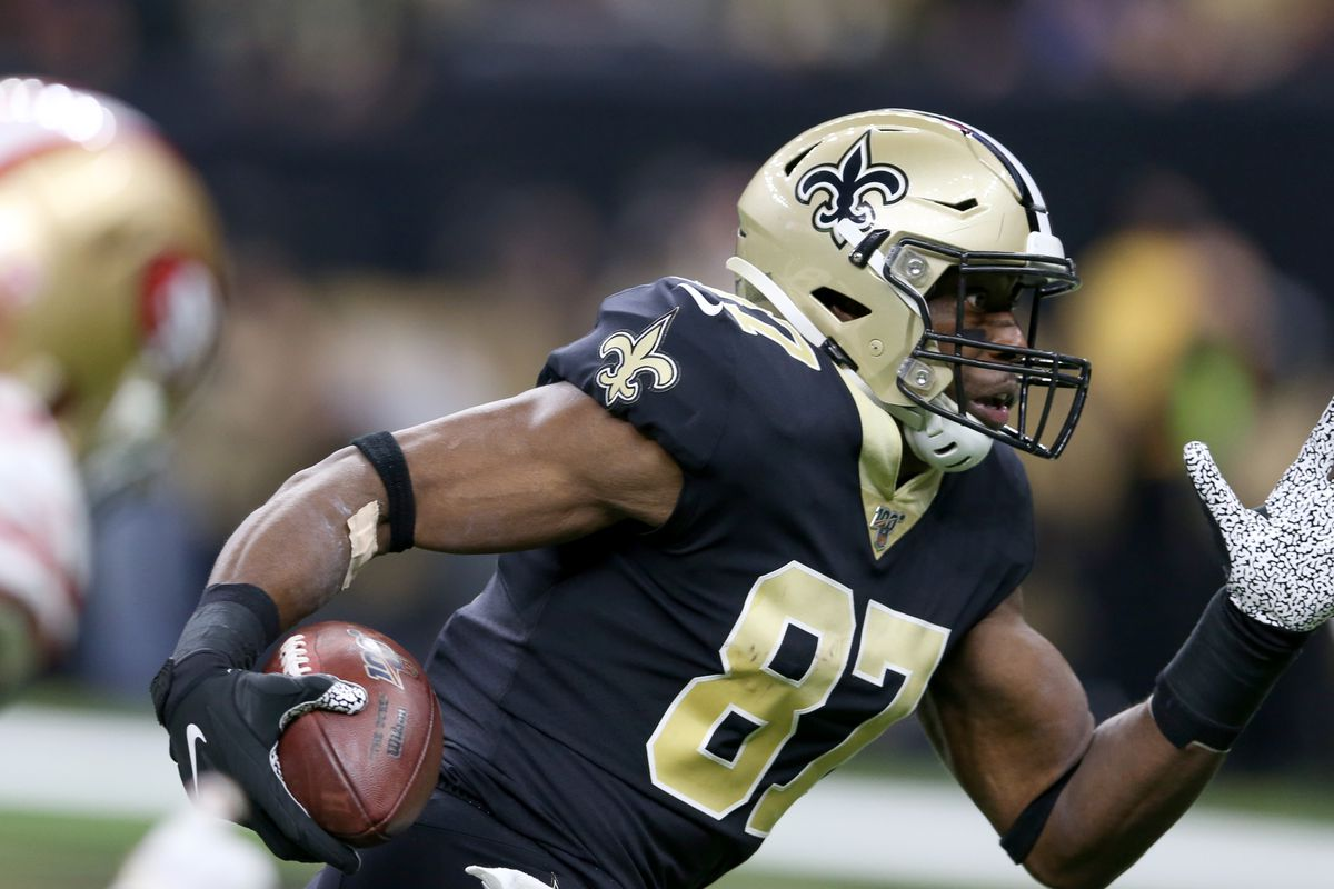 New Orleans Saints tight end Jared Cook runs with the ball to score a touchdown in the first quarter against the San Francisco 49ers at the Mercedes-Benz Superdome.