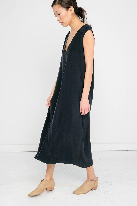 a model in a long black dress