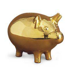 """<strong>Jonathan Adler</strong> Gold Piggy Bank, <a href=""""http://www.jonathanadler.com/gold-piggy-bank"""">$198</a>"""