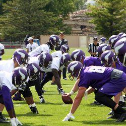 Jul 26, 2013; Mankato, MN, USA; Minnesota Vikings offense runs plays against the defense during training camp at Minnesota State University. Mandatory Credit: Brace Hemmelgarn-USA TODAY Sports