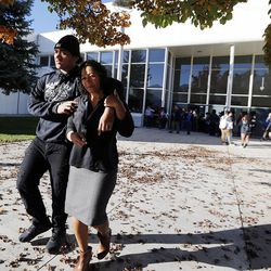 Aisea Unga and his mother, Seta, hold each other as they walk away from Mountain View High School in Orem on Tuesday, Nov. 15, 2016, after five students were stabbed in an apparent attack by a 16-year-old boy.