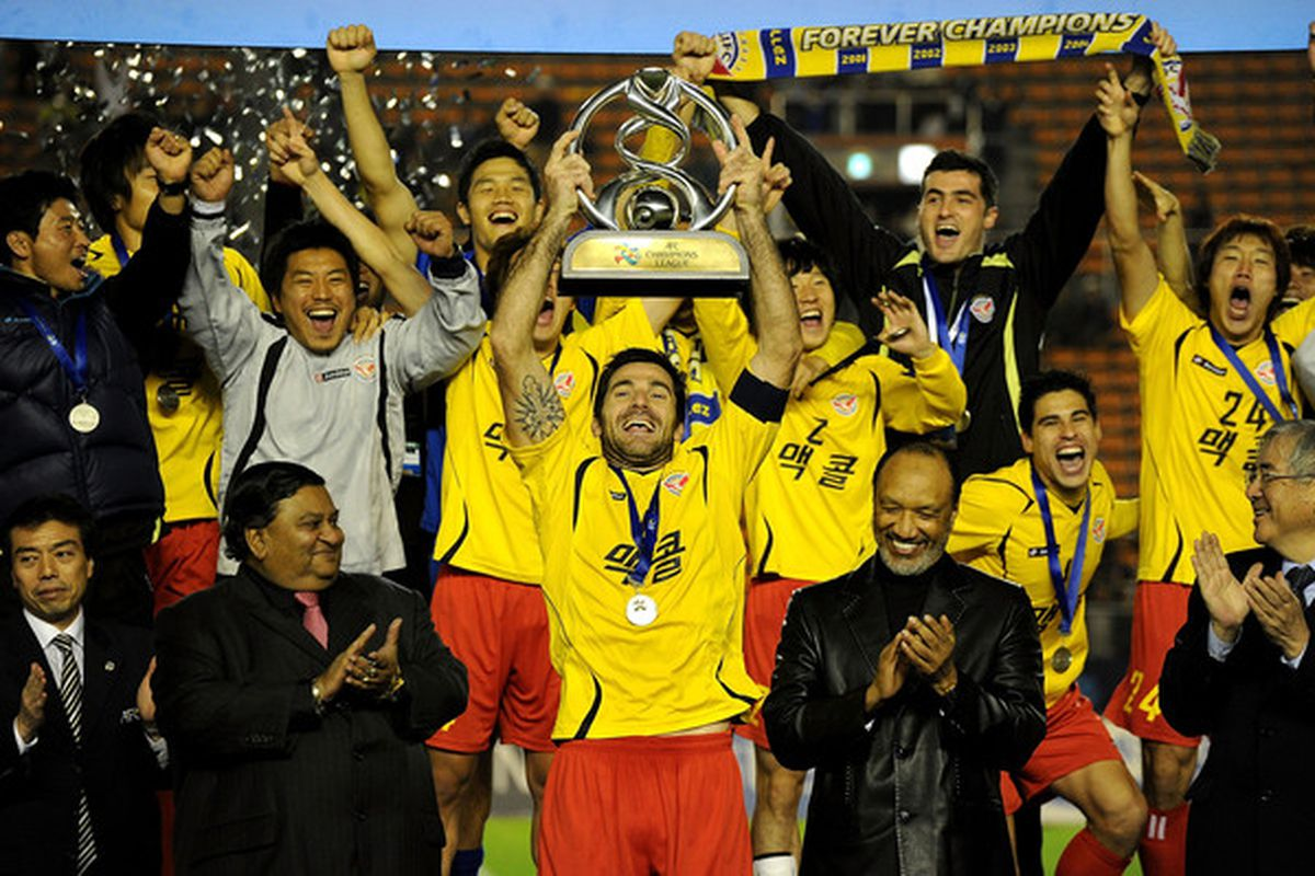One of two pictures we have of Seongnam doing something, so here they are raising the Asian Champions League trophy from a slightly different angle.