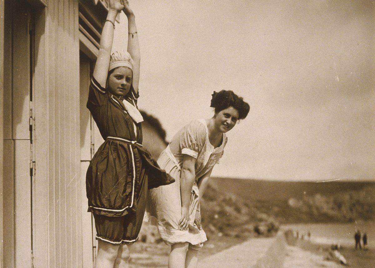 Two women prepare to swim in the 1890s