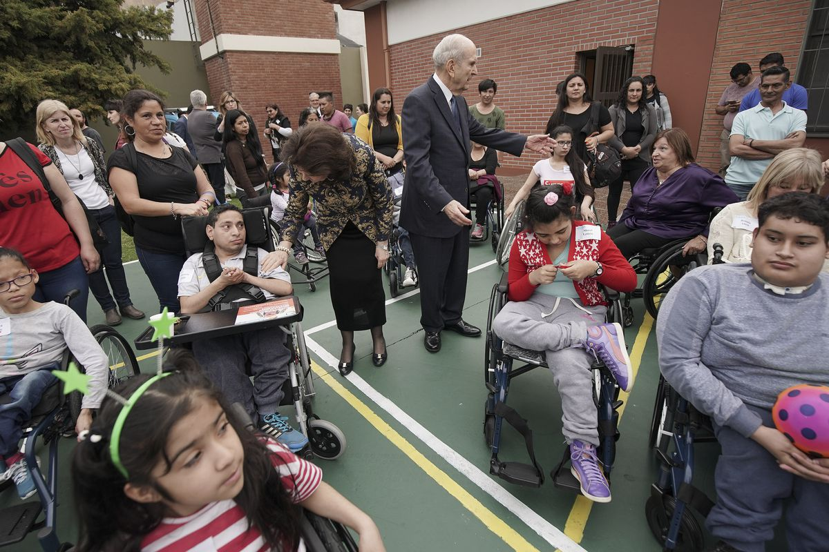 President Russell M. Nelson of The Church of Jesus Christ of Latter-day Saints and his wife Sister Wendy Nelson stand with wheelchair recipients after Latter-day Saint Charities donated the wheelchairs in Buenos Aires, Argentina on Wednesday, Aug. 28, 2019.
