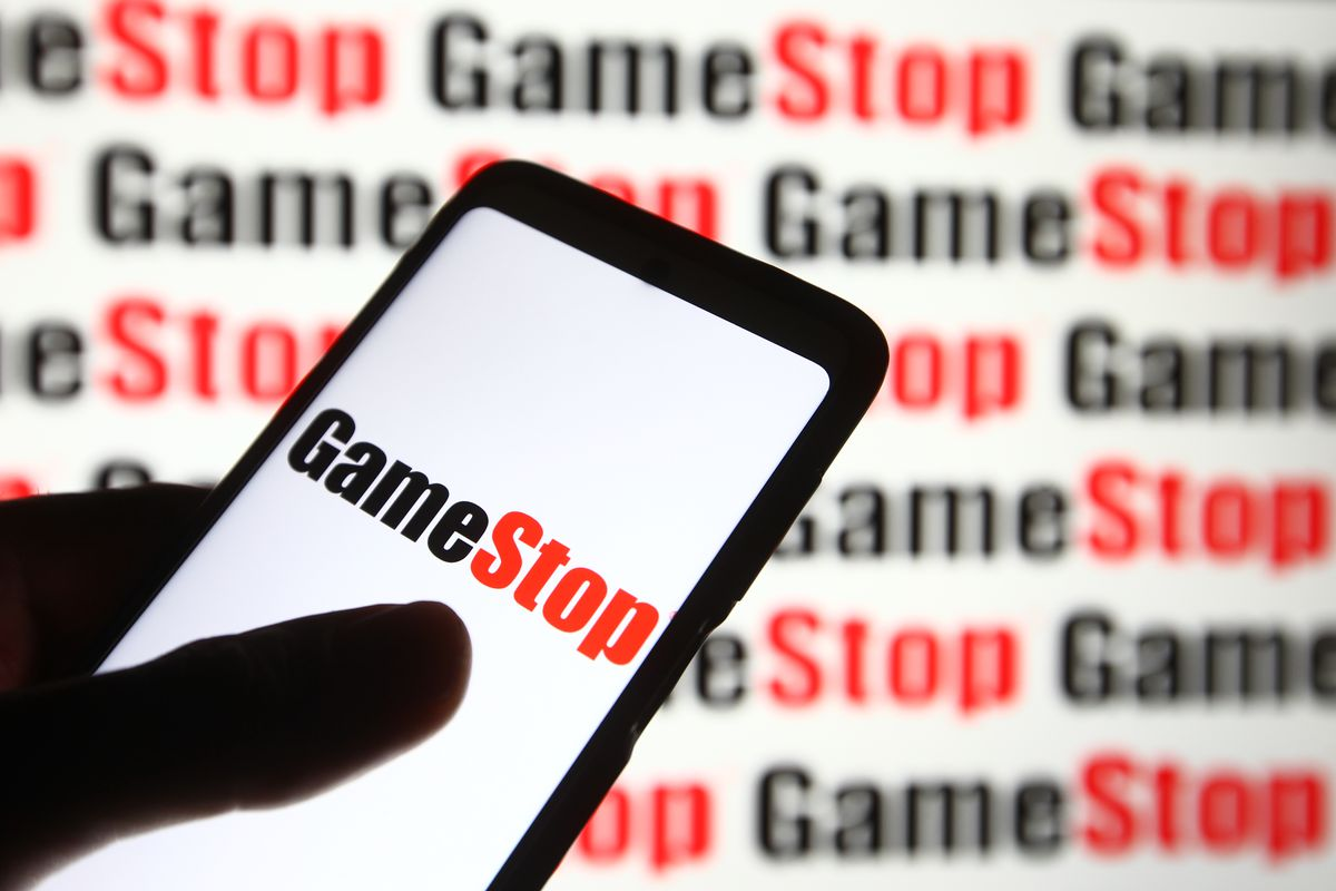 In this photo illustration a GameStop logo of the U.S. video...