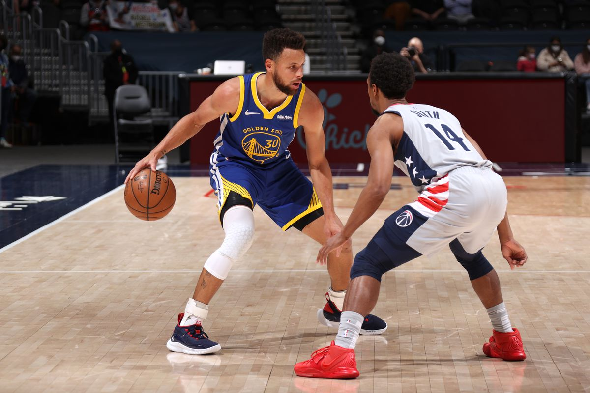 Stephen Curry #30 of the Golden State Warriors dribbles the ball during the game against the Washington Wizards on April 21, 2021 at Capital One Arena in Washington, DC.