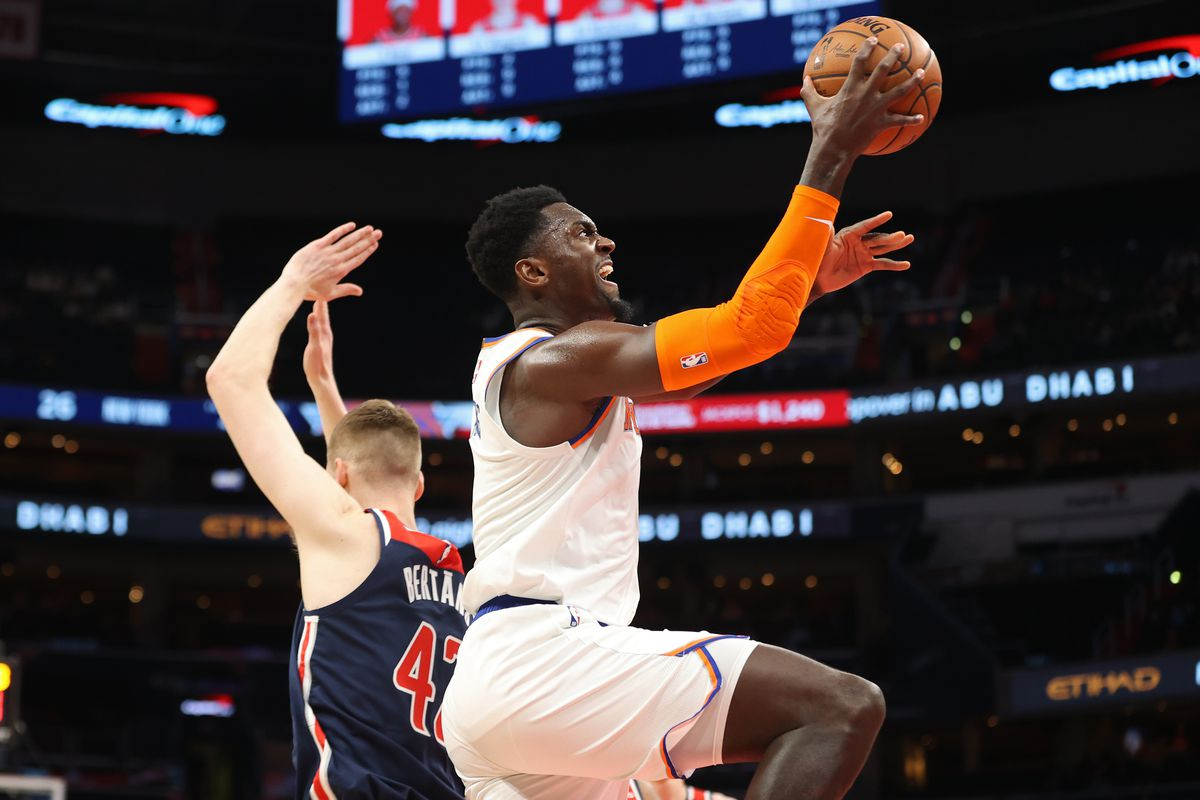 New York Knicks forward Bobby Portis drives to the basket as Washington Wizards forward Davis Bertans defends in the first quarter at Capital One Arena.