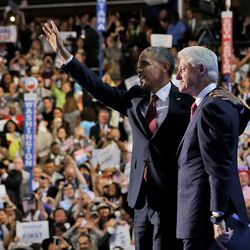 President Barack Obama, left, joins former President Bill Clinton, right, at the Democratic National Convention, Wednesday, Sept. 5, 2012, in Charlotte, N.C. (AP Photo/Pablo Martinez Monsivais)