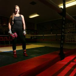 Boxer Whitney Gomez poses for photos after her workout at Fullmer Brothers Boxing Gym in South Jordan on Wednesday, June 7, 2017.