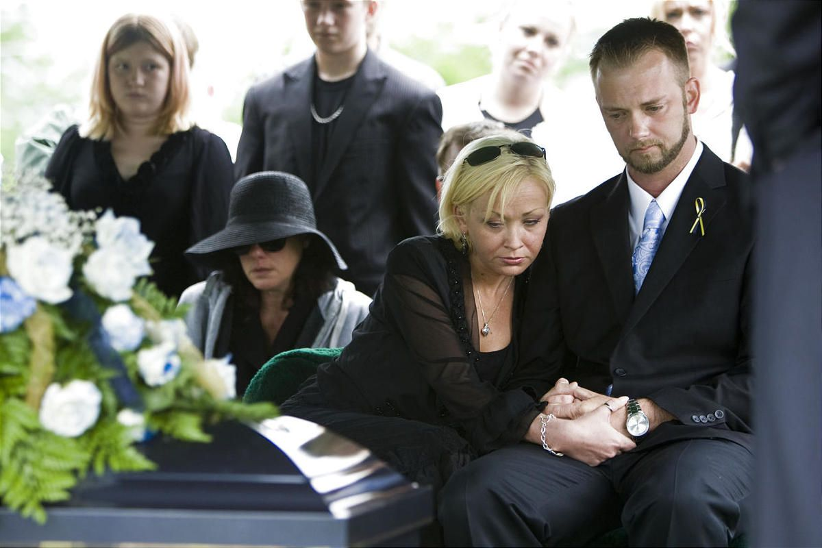 Joe Stacy and his fiance Becky Elswick listen to Evangelist Mike Rife at the graveside services for Ethan Stacy, a 4-year old boy who was allegedly abused and killed last year by his mother and her newlywed husband.