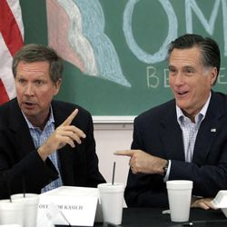 In this April 27, 2012 file photo, former presidential candidate Mitt Romney and Ohio Gov. John Kasich participate in a roundtable discussion in Westerville, Ohio. Kasich is one of at least six Republican contenders for the White House who will be in Utah through Saturday to meet with a select group of Romney's top contributors at an upscale ski resort.