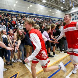 The Manti Templars celebrate after winning against the Judge Memorial Bulldogs during the 3A boys basketball semifinals at the Lifetime Activities Center in Taylorsville on Friday, Feb. 21, 2020.