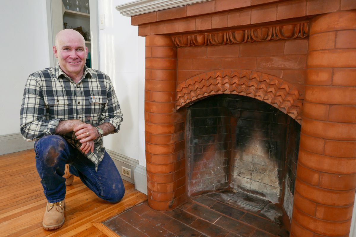 Mark McCullough Sits Near Fireplace in Need of Update