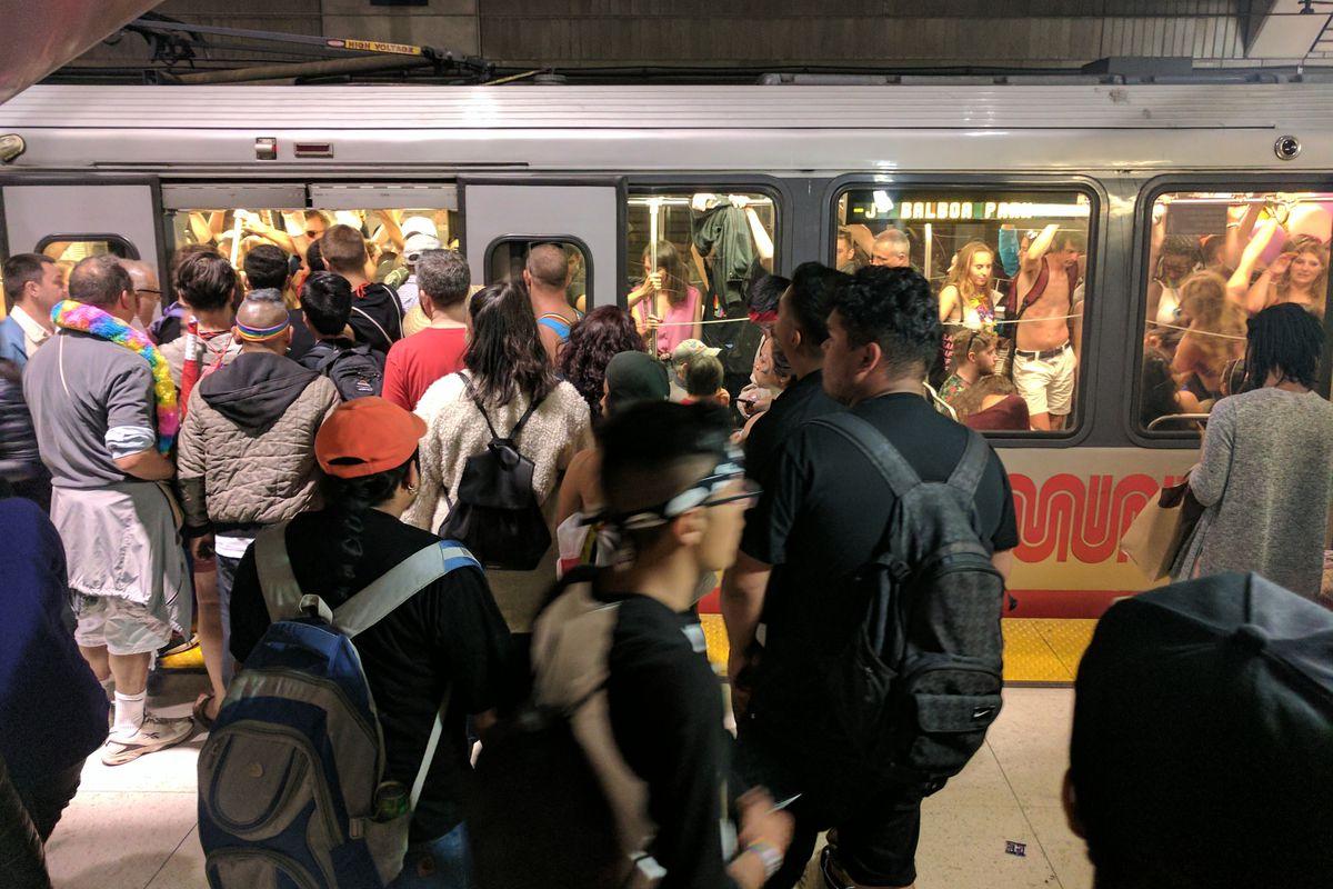 crowded muni underground train and station platform