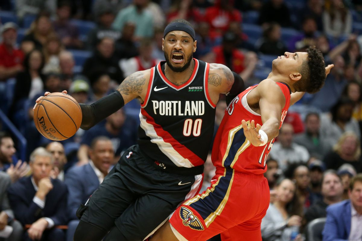 Portland Trail Blazers forward Carmelo Anthony is fouled by New Orleans Pelicans guard Frank Jackson in the second quarter at the Smoothie King Center.
