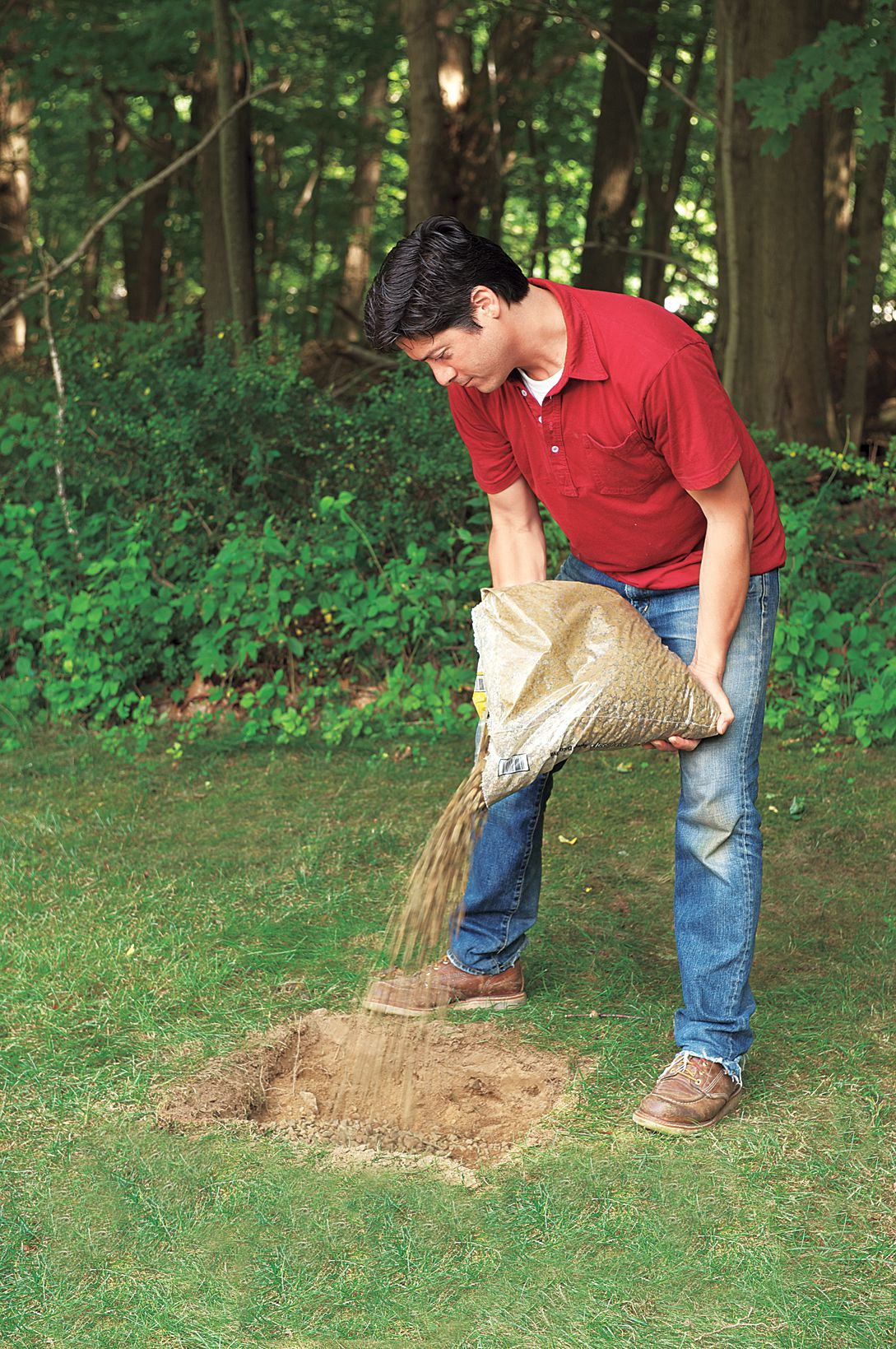 Man Adds Gravel Into Base For Planter Bench