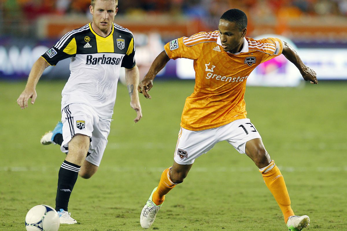 HOUSTON, TX - AUGUST 19:  Ricardo Clark #13 of the Houston Dynamo keeps the ball from Chad Marshall #14 of the Columbus Crew at BBVA Compass Stadium on August 19, 2012 in Houston, Texas.  (Photo by Bob Levey/Getty Images)