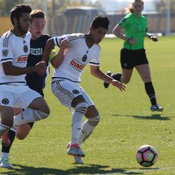 Midfielder Omar Ayala (right) and Matthew Real shield off a Bethesda player