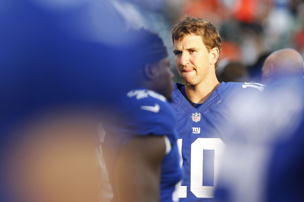 Eli Manning watches the action Friday night.