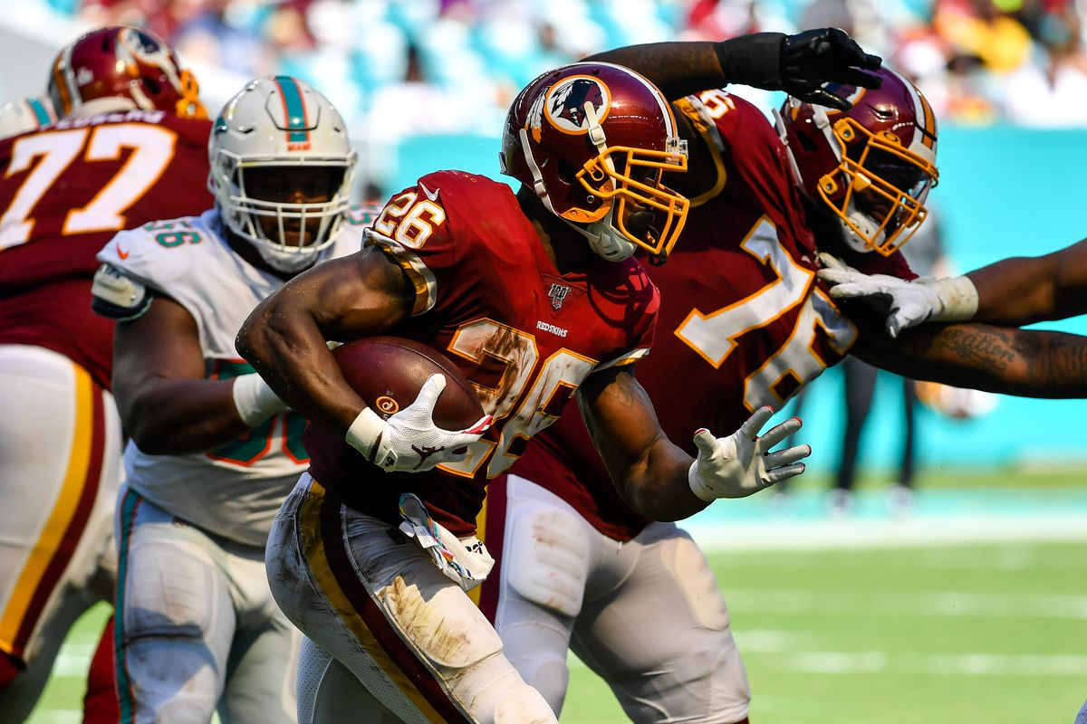 Washington running back Adrian Peterson carries the ball against the Miami Dolphins at Hard Rock Stadium.
