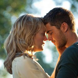 """In this film image released by Warner Bros, Taylor Schilling, left, and Zac Efron are shown in a scene from """"The Lucky One."""""""