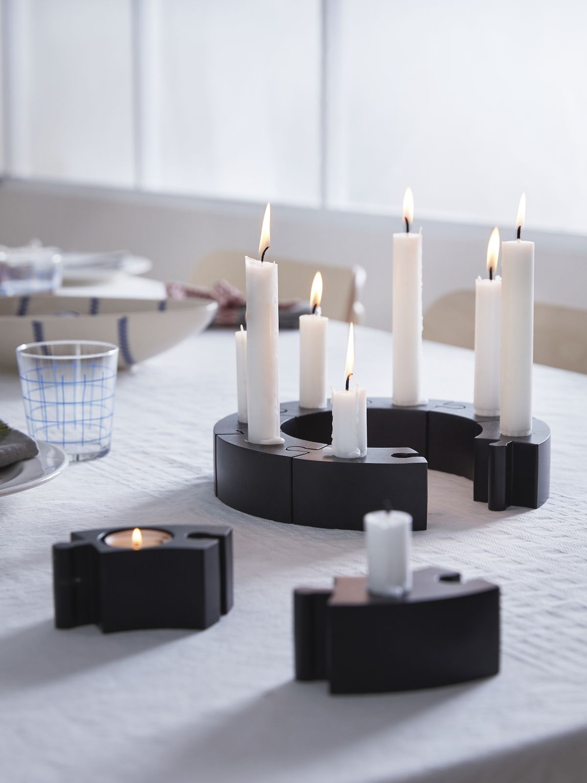Curved candle holders lock into each other like a puzzle.