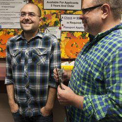 Jason McDermaid, right, waits in line for a marriage certificate with Zachary Smallwood at the Salt Lake County Clerk's Office in Salt Lake City, Monday, Oct. 6, 2014.