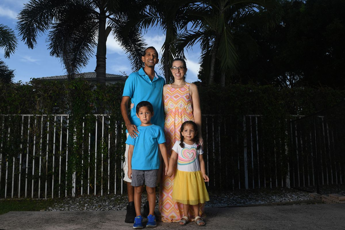 Raif Mohamed, left, and his wife, Rorri Geller-Mohamed, are seen with their children Omar, age 5, and Mia, age 3, at their home in Lake Worth, Fla., Thursday, Sept. 18, 2020. Families that are taking part in the Black Lives Matter movement are tackling issues of race head-on at home.