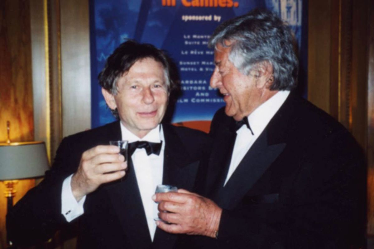 In this May 2002 photo, producer Gene Gutowski, right, chats with film director Roman Polanski in Cannes, France. AP photo
