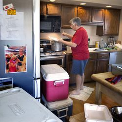 Ed Snoddy prepares Thanksgiving meals in his kitchen before heading out to deliver them to homeless people in Salt Lake City on Thursday, Nov. 24, 2016. Snoddy and Pamela Atkinson have been delivering home-cooked meals on Thanksgiving and Christmas for 20 years.