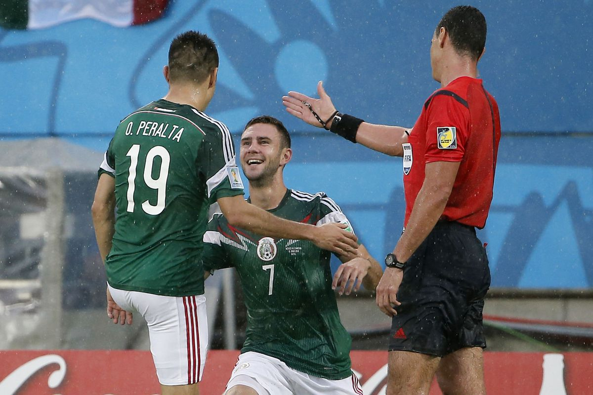 Layun and Peralta share a moment after Mexico's goal.