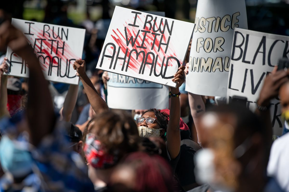 Demonstrators on May 8 protest the shooting death of Ahmaud Arbery at the Glynn County Courthouse in Brunswick, Georgia.