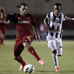 U.S. Real Salt Lake Fabian Espindola, left, and Panama's Tauro FC Marcos Sanchez fight for the ball during a CONCACAF Champions League soccer match in Panama City, Tuesday, Sept. 18, 2012. (AP Photo/Arnulfo Franco)