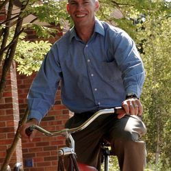 Matt Kelly on the Felt cruiser bike he bought for about $500 ? without telling his wife. Kelly is now a  Personal Finance Coach and author. He has since sold the bike. Photograph by McCarson L. Jones of Red Scarf Shots .