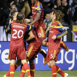 Real Salt Lake forward Alvaro Saborio (15) is congratulated by his teammates following his first goal during a game at Rio Tinto Stadium in Sandy on Saturday, March 29, 2014.