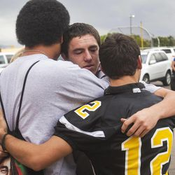 Union High School football players console a teammate Wednesday, Sept. 25, 2013, who was told he wouldn't be playing in Friday's homecoming game. The football coaches at Union High in Roosevelt have taken a stand against poor performance in the classroom and bullying outside the classroom, including disrespect of teachers and students.