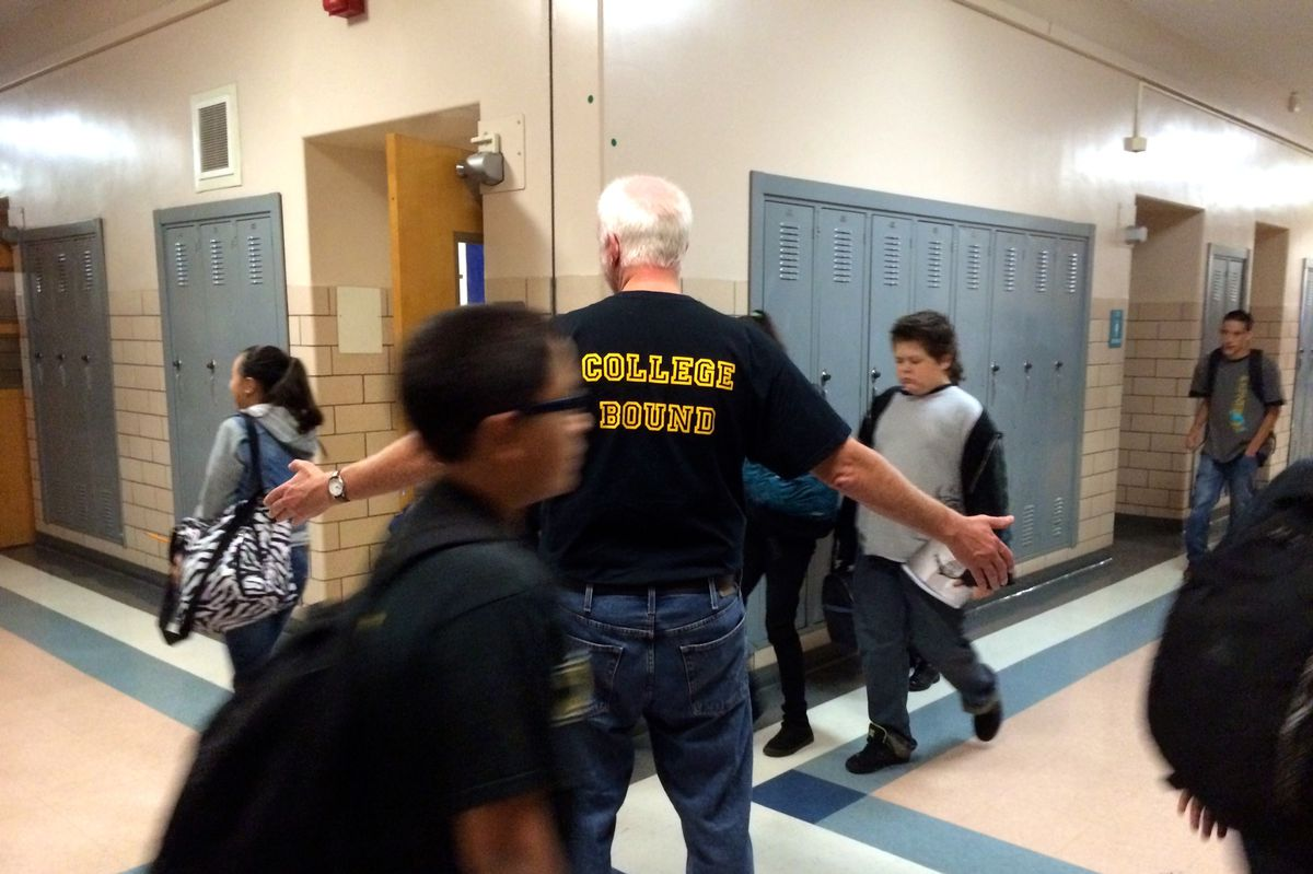 Student advisor Steve Harvey, center, acts as a traffic medium as Kepner Middle School students pass between classes.