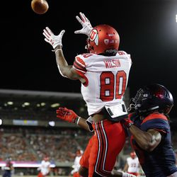 Utah Utes wide receiver Siaosi Wilson pulls in a pass that is ruled out of bounds with Arizona Wildcats safety Demetrius Flannigan-Fowles  defending in Tucson, Arizona, on Friday, Sept. 22, 2017. Utah beat Arizona 30-24.