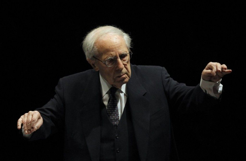 In this Dec.20, 2011 file photo, French conductor and composer Pierre Boulez conducts the Paris Orchestra at the Louvre museum in Paris.   AP Photo/Christophe Ena