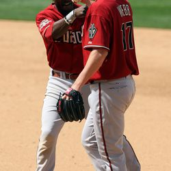 Webb is congratulated by Orlando Hudson after beating the runner to first for an out during the April 27th, 2008 game at Petco