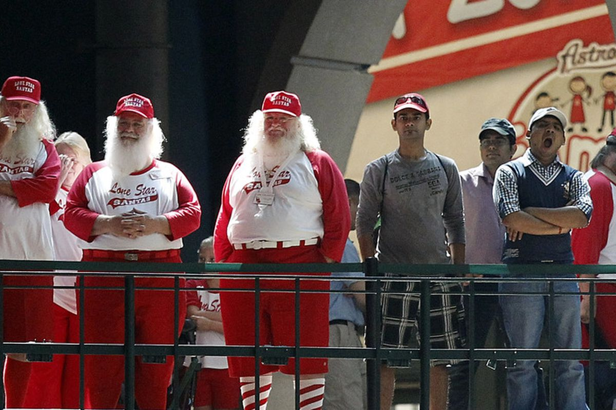 HOUSTON - JUNE 24:  Members of the Lone Star Santas watch the ninth inning between the Cleveland Indians and Houston Astros at Minute Maid Park on June 24, 2012 in Houston, Texas.  (Photo by Bob Levey/Getty Images)