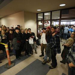 Couples wait to get marriage licenses at the Salt Lake County clerk's office on Monday, Dec. 23, 2013, after the 10th Circuit Court of Appeals in Denver on Sunday denied a stay of a federal judge's ruling allowing for same-sex marriage in Utah pending a hearing Monday morning.