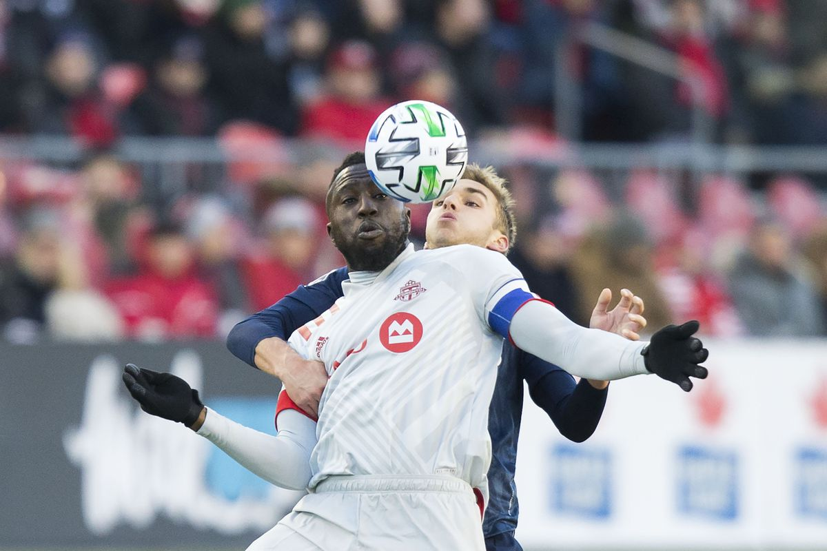 Jozy Altidore front of Toronto FC vies with James Sands of New York City FC during the 2020 Major League Soccer match between Toronto FC and New York City FC at BMO Field in Toronto, Canada, March 7, 2020.