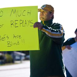 Green Bay Packers fan Mike LePak holds a sign Tuesday, Sept. 25, 2012 on Lombardi Avenue in Green Bay, Wisc., in protest of a controversial call in the Packers 14-12 loss to the Seattle Seahawks, Monday night in Seattle. Just when it seemed that NFL coaches, players and fans couldn't get any angrier, along came a fiasco that trumped any of the complaints from the weekend.